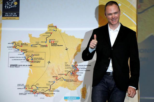 Tour de France 2017 winner Chris Froome of Britain poses with map of the itinerary of the 2018 Tour de France cycling race during a news conference in Paris, France, October 17, 2017. The world's greatest cycling event will start from Noirmoutier-en-L'Ile on July 7 and will finish at the Champs Elysees in Paris on July 29. REUTERS/Charles Platiau