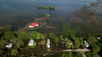 """<p>Another area of the American midwest is submerged in perhaps unprecedented flooding, this time along the Missisippi River. Parts of Missouri, Kansas, Nebraska, Oklahoma, Arkansas, and Texas were issued further flood watches this week, according to <a href=""""https://www.usatoday.com/story/news/nation/2019/05/07/midwest-flooding-soggy-midwest-braces-more-storms/1127348001/"""" rel=""""nofollow noopener"""" target=""""_blank"""" data-ylk=""""slk:USA Today"""" class=""""link rapid-noclick-resp""""><em>USA Today</em></a>, as areas already battered by storms and rain faced another onslaught that threatened to reengage the river floodwaters that had started to recede. The conditions have hit hard in small towns like Davenport, Iowa, which saw the nearby Mississippi crest to a record-high of more than 22 feet last week. In Missouri, close to a dozen levees have been breached or are threatened. It's the culmination of Midwest flooding that, according to the <em><a href=""""https://www.washingtonpost.com/national/flooding-wreaks-havoc-along-mississippi-river-a-transit-hub-for-1b-in-goods/2019/05/06/bddf5194-7049-11e9-b5ca-3d72a9fa8ff1_story.html?utm_term=.67db7bbbe0e5"""" rel=""""nofollow noopener"""" target=""""_blank"""" data-ylk=""""slk:Washington Post"""" class=""""link rapid-noclick-resp"""">Washington Post</a></em>, has already caused $12 billion in damage this year. Here are some of the most striking photos for a glimpse of what it's like on the ground.<br></p>"""