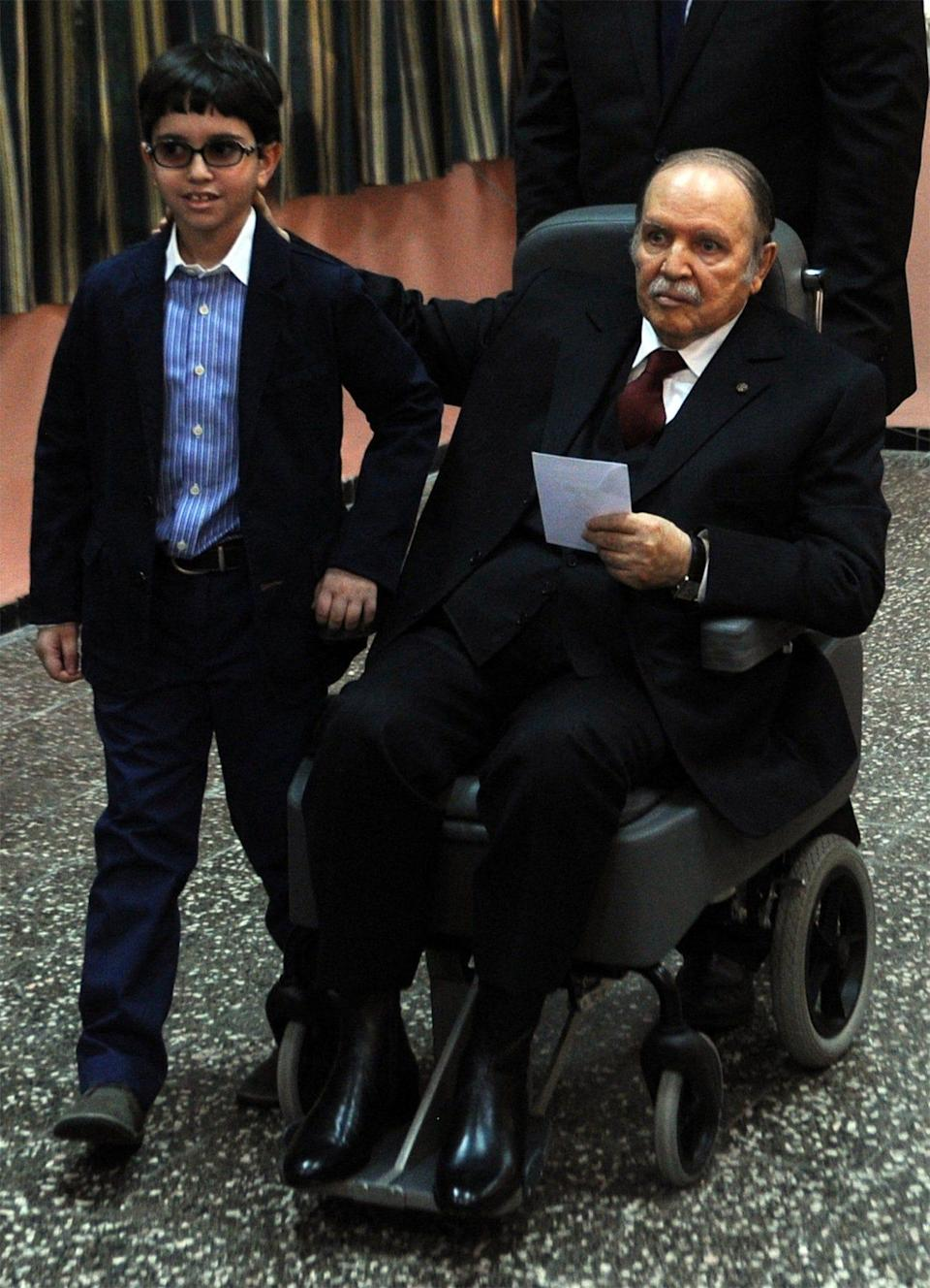 President Bouteflika was ailing in the later years of his rule: here he is pushed in a wheelchair next to his nephew before casting his ballot in Algiers, 2014 - FAROUK BATICHE/AFP via Getty Images