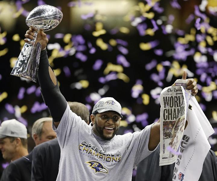 Baltimore Ravens linebacker Ray Lewis (52) holds a newspaper and the Vince Lombardi Trophy as he celebrates after defeating the San Francisco 49ers 34-31 in the NFL Super Bowl XLVII football game, Sunday, Feb. 3, 2013, in New Orleans. (AP Photo/Evan Vucci)