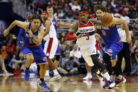 FILE PHOTO: Oct 31, 2015; Washington, DC, USA; Washington Wizards guard Bradley Beal (3) dribbles the ball up court as New York Knicks guard Sasha Vujacic (18) chases in the second quarter at Verizon Center. Mandatory Credit: Geoff Burke-USA TODAY Sports/Reuters