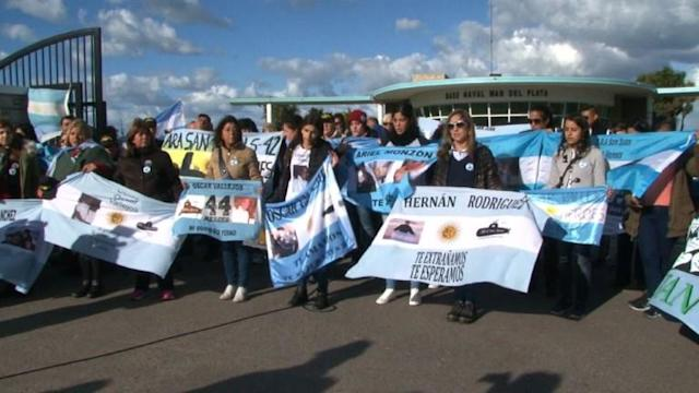Relatives and friends of the crew of the Argentine submarine which went missing six months ago, march in silence and gather at the Mar del Plata naval base to lobby for the continuation of the search mission.