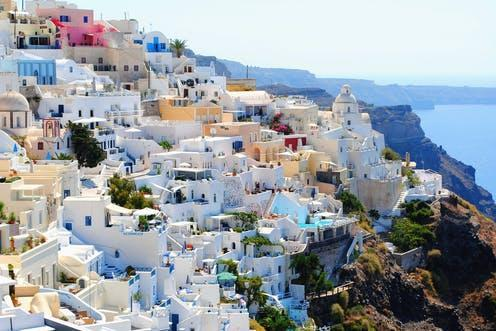 """<span class=""""caption"""">Painting buildings white is a centuries-old method of staving off heat in countries like Greece</span> <span class=""""attribution""""><a class=""""link rapid-noclick-resp"""" href=""""https://pixabay.com/photos/santorini-travel-holidays-vacation-1404852/"""" rel=""""nofollow noopener"""" target=""""_blank"""" data-ylk=""""slk:SophiaPapageorge/Pixabay"""">SophiaPapageorge/Pixabay</a>, <a class=""""link rapid-noclick-resp"""" href=""""http://creativecommons.org/licenses/by/4.0/"""" rel=""""nofollow noopener"""" target=""""_blank"""" data-ylk=""""slk:CC BY"""">CC BY</a></span>"""