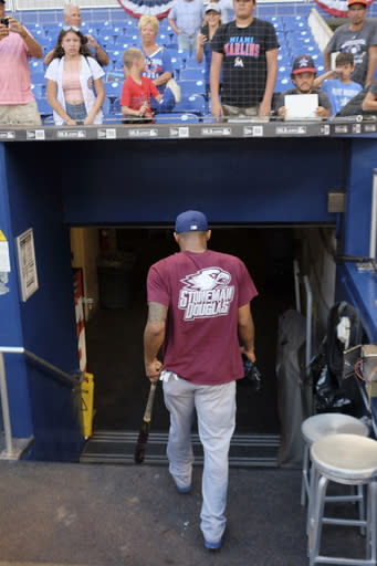Chicago Cubs' Addison Russell walks back to the locker room after taking batting practice prior to a baseball gameagainst the Miami Marlins in Miami, Friday, March 30, 2018. (AP Photo/Gaston De Cardenas)