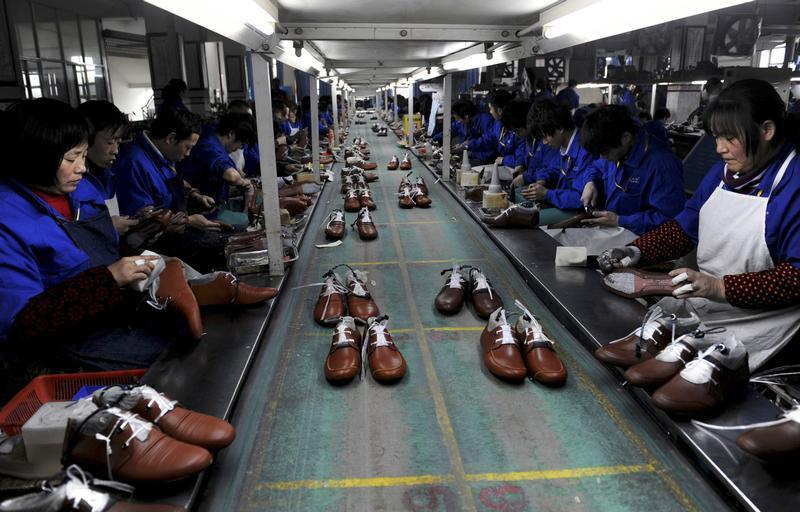 Employees work at a shoe factory in Lishui