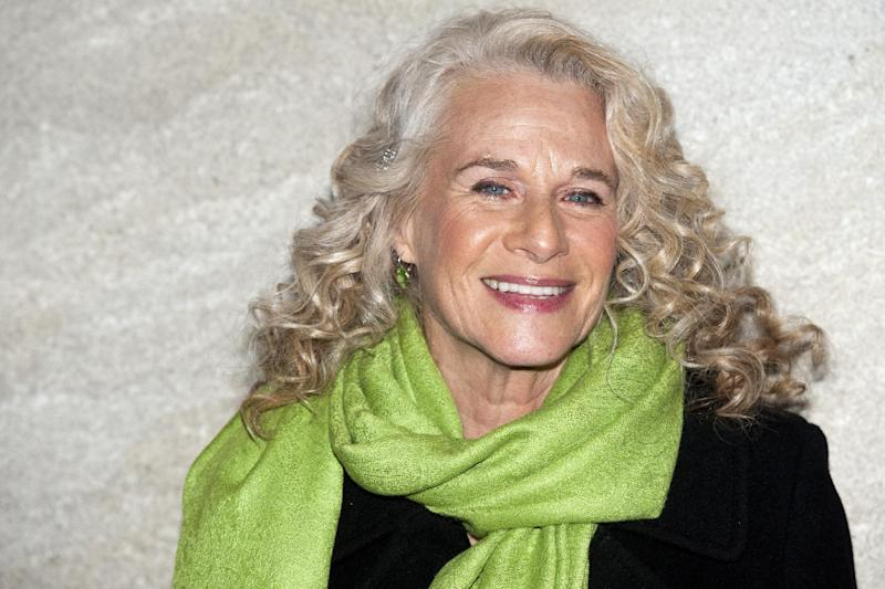 "FILE - In this Nov. 30, 2011 file photo, musician Carole King attends the Rockefeller Center Christmas tree lighting, in New York. King, now a best-selling author, doubts she will ever write another song and suggested that her 2010 ""Troubadours Reunion"" concert tour with James Taylor would be her last. She recently released a memoir called, ""A Natural Woman."" (AP Photo/Charles Sykes, file)"