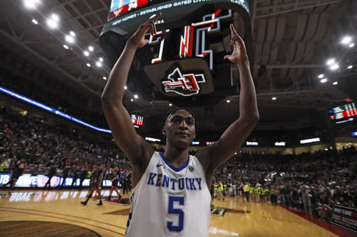 Kentucky's Immanuel Quickley (5) celebrates on the court after an NCAA college basketball game against Texas Tech, Saturday, Jan. 25, 2020, in Lubbock, Texas. (AP Photo/Brad Tollefson)