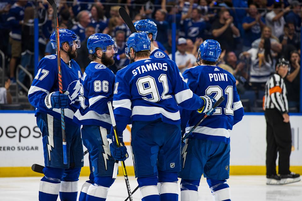 Tampa Bay Lightning celebrate a goal by Brayden Point #21 against the New York Islanders
