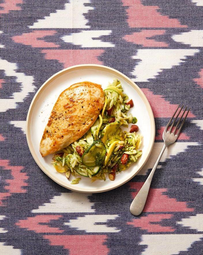 """<p>It's definitely an <a href=""""https://www.goodhousekeeping.com/food-recipes/easy/g2352/quick-summer-dinner-recipes/"""" rel=""""nofollow noopener"""" target=""""_blank"""" data-ylk=""""slk:al fresco meal designed for summer nights"""" class=""""link rapid-noclick-resp""""><em>al fresco</em> meal designed for summer nights</a>. Orzo and zucchini (plus squash!) make for a delicious sidekick to chicken — in less than 10, no less!</p><p><em><a href=""""https://www.goodhousekeeping.com/food-recipes/a28611486/seared-chicken-with-pesto-zucchini-orzo-recipe/"""" rel=""""nofollow noopener"""" target=""""_blank"""" data-ylk=""""slk:Get the recipe for Seared Chicken With Pesto Zucchini Orzo »"""" class=""""link rapid-noclick-resp"""">Get the recipe for Seared Chicken With Pesto Zucchini Orzo »</a></em></p>"""