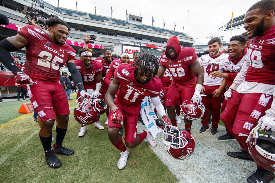 Temple cornerback Linwood Crump (11) celebrates with teammates after their 30-28 win over Memphis in an NCAA college football, Saturday, Oct. 12, 2019, in Philadelphia. T (AP Photo/Chris Szagola)