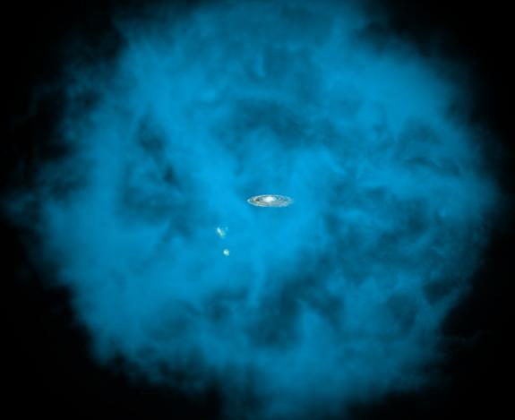 This artist's illustration shows an enormous halo of hot gas (in blue) around the Milky Way galaxy. Also shown, to the lower left of the Milky Way, are the Small and Large Magellanic Clouds, two small neighboring galaxies. The halo of gas is sh