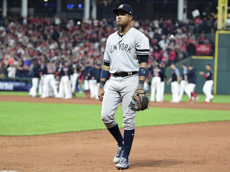 Yankees' second baseman Starlin Castro walks off the field while the Indians celebrate their Game 2 comeback win. (AP)