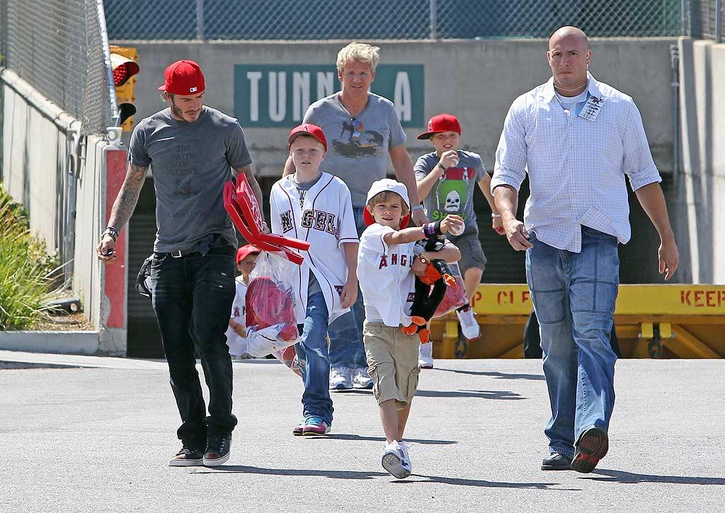 """British BFFs David Beckham and Gordon Ramsay took their kids -- Brooklyn, Romeo, and Cruz Beckham, and Jack Ramsay -- to see the Baltimore Orioles play the Los Angeles Angels in Anaheim, California, on Sunday. Skippy/<a href=""""http://www.infdaily.com"""" target=""""new"""">INFDaily.com</a> - August 29, 2010"""