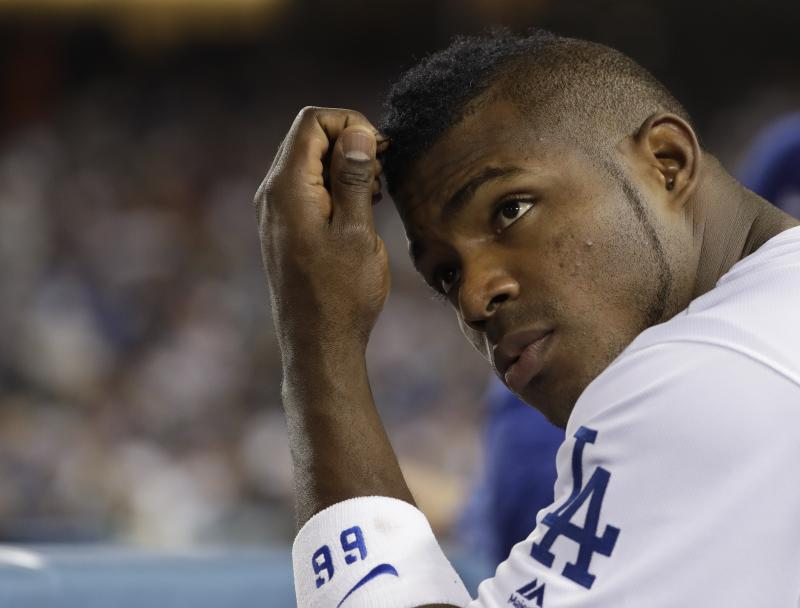 Yasiel Puig wears the face of frustration after the Dodgers blew numerous scoring chances. (AP)