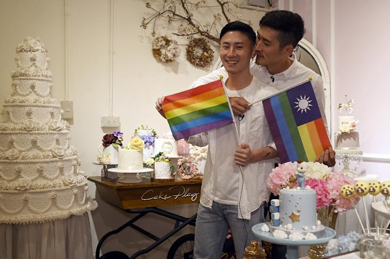 Couple Shane Lin and Marc Yuan are expectedly waiting for Asia's first gay marriage law to pass and planning to register for their own wedding at the end of May -- if the government's bill passes (AFP Photo/SAM YEH)