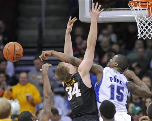 Seton Hall's Herb Pope. right, fouls West Virginia's Kevin Noreen during the first half of an NCAA college basketball game Friday, Dec. 30, 2011, in Newark, N.J. (AP Photo/Bill Kostroun)