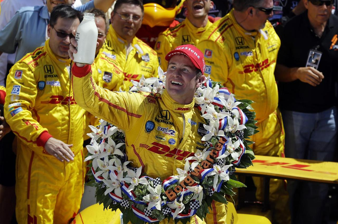 Ryan Hunter-Reay celebrates after winning the Indianapolis 500 IndyCar auto race at the Indianapolis Motor Speedway in Indianapolis, Sunday, May 25, 2014. (AP Photo/Michael Conroy)