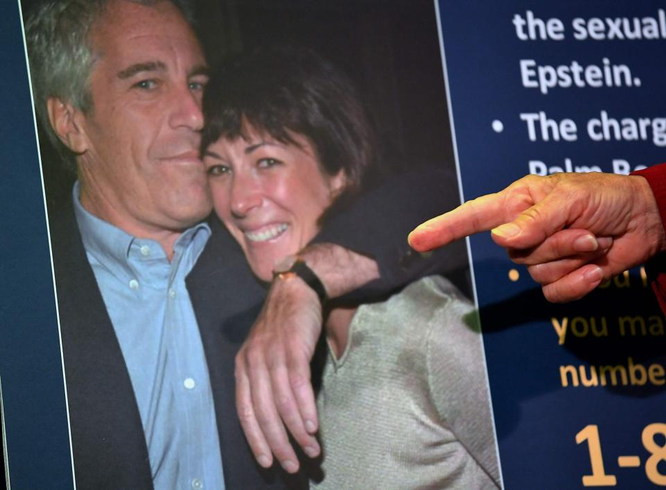 A photo of Ghislaine Maxwell and Jeffrey Epstein is shown during a press conference held by US prosecutors in New York - AFP