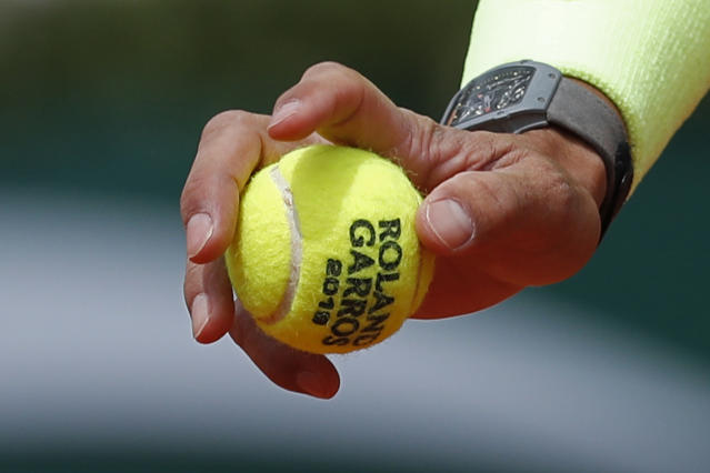 "FILE - In this Monday, May 27, 2019, file photo, Spain's Rafael Nadal prepares to serve against Germany's Yannick Hanfmann during their first round match of the French Open tennis tournament at the Roland Garros stadium in Paris. English-speakers tend to go with ""French Open,"" even though that's not used by the event itself. Most of the rest of the world says ""Roland Garros,"" which is the facility that hosts the tournament and is named in memory of a World War I fighter pilot. But what hardly ever is uttered is the original name of the tournament ""Internationaux de France"", which translates to ""International Championships of France."" (AP Photo/Pavel Golovkin, File)"