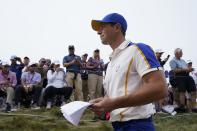 Team Europe's Rory McIlroy walks to the fourth hole during a Ryder Cup singles match at the Whistling Straits Golf Course Sunday, Sept. 26, 2021, in Sheboygan, Wis. (AP Photo/Charlie Neibergall)