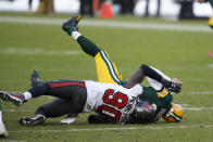 Tampa Bay Buccaneers' Jason Pierre-Paul sacks Green Bay Packers quarterback Aaron Rodgers during the first half of the NFC championship NFL football game in Green Bay, Wis., Sunday, Jan. 24, 2021. (AP Photo/Matt Ludtke)