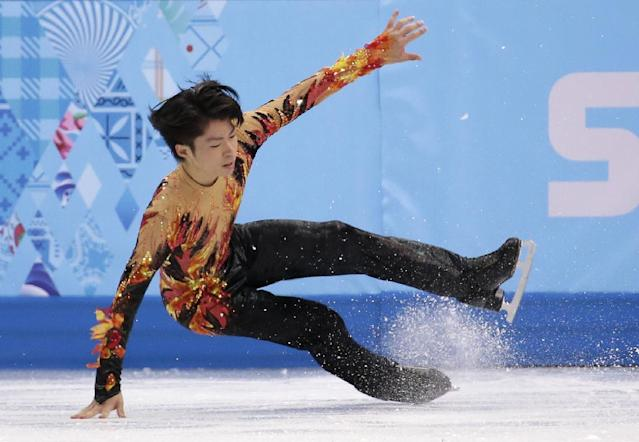 Tatsuki Machida of Japan falls as he competes in the men's free skate figure skating final at the Iceberg Skating Palace during the 2014 Winter Olympics, Friday, Feb. 14, 2014, in Sochi, Russia