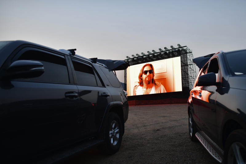 MORRISON, CO - AUGUST 22: A screen shows The Big Lebowski during a drive-in movie on August 22, 2020 at the Red Rocks Amphiteatre in Morrison, Colorado. The famed concert locale features physically distanced summer creative planning of weekend yoga and a drive-in movie theater during the coronavirus pandemic. (Photo by Mark Makela/Getty Images)