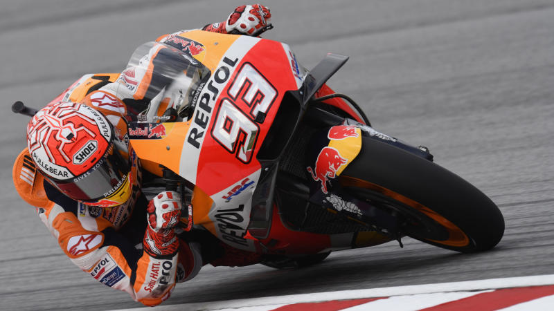Marquez claims win at Sepang after Rossi crash