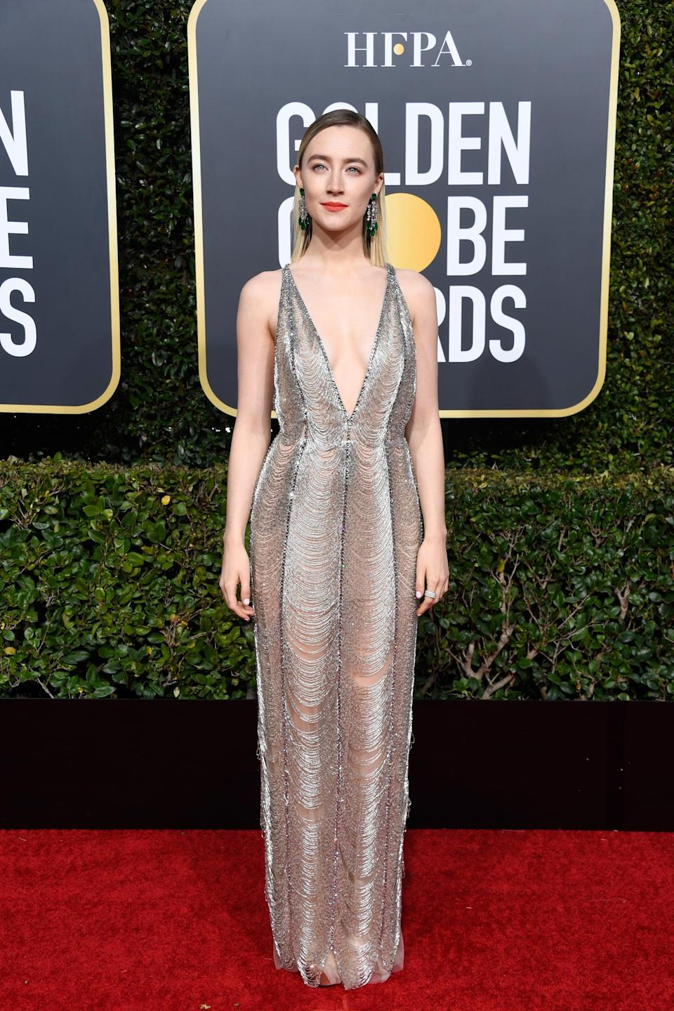 <p>Wearing a Gucci dress with Chopard jewels.</p>