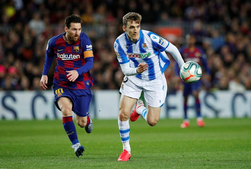 Soccer Football - La Liga Santander - FC Barcelona v Real Sociedad - Camp Nou, Barcelona, Spain - March 7, 2020 Barcelona's Lionel Messi in action with Real Sociedad's Diego Llorente REUTERS/Albert Gea