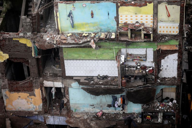 Damaged rooms of a building are seen after a portion of a three-storey residential building collapsed in Bhiwandi on the outskirts of Mumbai, India