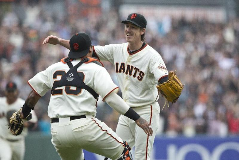 Tim Lincecum of the San Francisco Giants celebrates with Hector Sanchez after the game at AT&T Park on June 25, 2014 in San Francisco, California