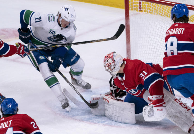 Montreal Canadiens goaltender Carey Price stops Vancouver Canucks' Loui Eriksson during the first period of an NHL hockey game Tuesday, Feb. 25, 2020, in Montreal. (Paul Chiasson/The Canadian Press via AP)