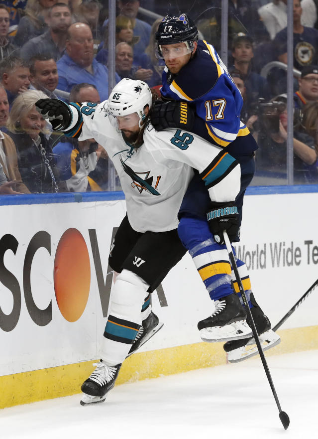 St. Louis Blues left wing Jaden Schwartz (17) lands on the back of San Jose Sharks defenseman Erik Karlsson (65), of Sweden, during the third period in Game 3 of the NHL hockey Stanley Cup Western Conference final series Wednesday, May 15, 2019, in St. Louis. (AP Photo/Jeff Roberson)