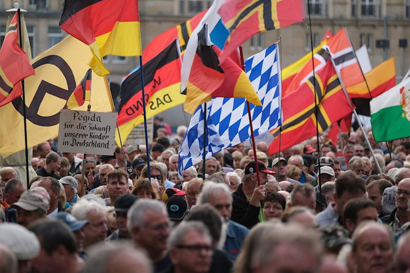 """(Bloomberg) -- Angela Merkelwas expecting a friendly chat with business women when she visitedDresdenearlier this month. Instead, far-right protesters jeeredthe German Chancellor's arrival.Hundreds of demonstrators from the Patriotic Europeans Against the Islamization of the West, a group known as Pegida, gathered in the historic city to voice their anger at Merkel and her decision to welcome over a million refugees since 2015. One threw a bottle at a journalist, another gave a Nazi salute, while a third denied the Holocaust, a criminal offense in Germany.A posterbearing Merkel's image read: Terrorists Welcome.Despite nearly a decade of consistent economic growth, there's growing fatigue with Merkel and the ruling parties, particularly in the former communist East, which has undergone decades of social and economic change. The region that saw massive right-wing protests last year is now back in focus as voters in three states go to the polls this fall. In two of them –Saxony and Brandenburg – Merkel's Christian Democrats and their junior partner, the Social Democrats, may lose for the first time since reunification in 1990 – to theupstart Alternative for Germany, or AfD. That could not only implode her fragile coalition but upend a political landscape dominated by two parties since World War II.""""That is the writing on the wall for the traditional parties,""""Josef Janning, head of the Berlin office of the European Council on Foreign Relations, said in an interview. """"This will shake up the system.""""Merkel's coalition is already hanging by a thread, with many Social Democrats saying they need to abandon government and return to their roots to stem the hemorrhaging of support in opinion polls. Disagreements, whether on defense or climate, surface daily within the coalition and a poor showing in the East could give the SPD the final push to jump ship.Ground ZeroMerkel and her Christian Democratic Union, or CDU, have also suffered massive losses in the former East, where the"""