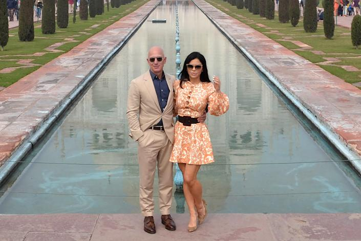 Jeff Bezos, left, is pictured with his girlfriend Lauren Sanchez, right, outside the Taj Mahal in January.