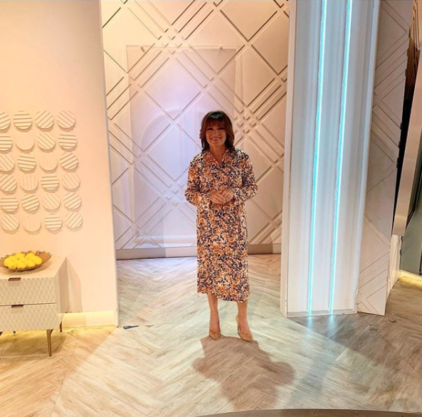 """<p>Lorraine found an absolute steal from very with this spring floral number for only 22 quid!</p><p><strong>V by Very</strong></p><p>Slash Neck Plisse Midi Dress Floral Print - £22</p><p><a class=""""body-btn-link"""" href=""""https://go.redirectingat.com?id=127X1599956&url=https%3A%2F%2Fwww.very.co.uk%2Fv-by-very-slash-neck-plisse-midi-dress-floral-print%2F1600396748.prd&sref=http%3A%2F%2Fwww.prima.co.uk%2Fleisure%2Fcelebrity%2Fg30751501%2Florraine-kelly-fashion%2F"""" target=""""_blank"""">BUY NOW</a></p>"""