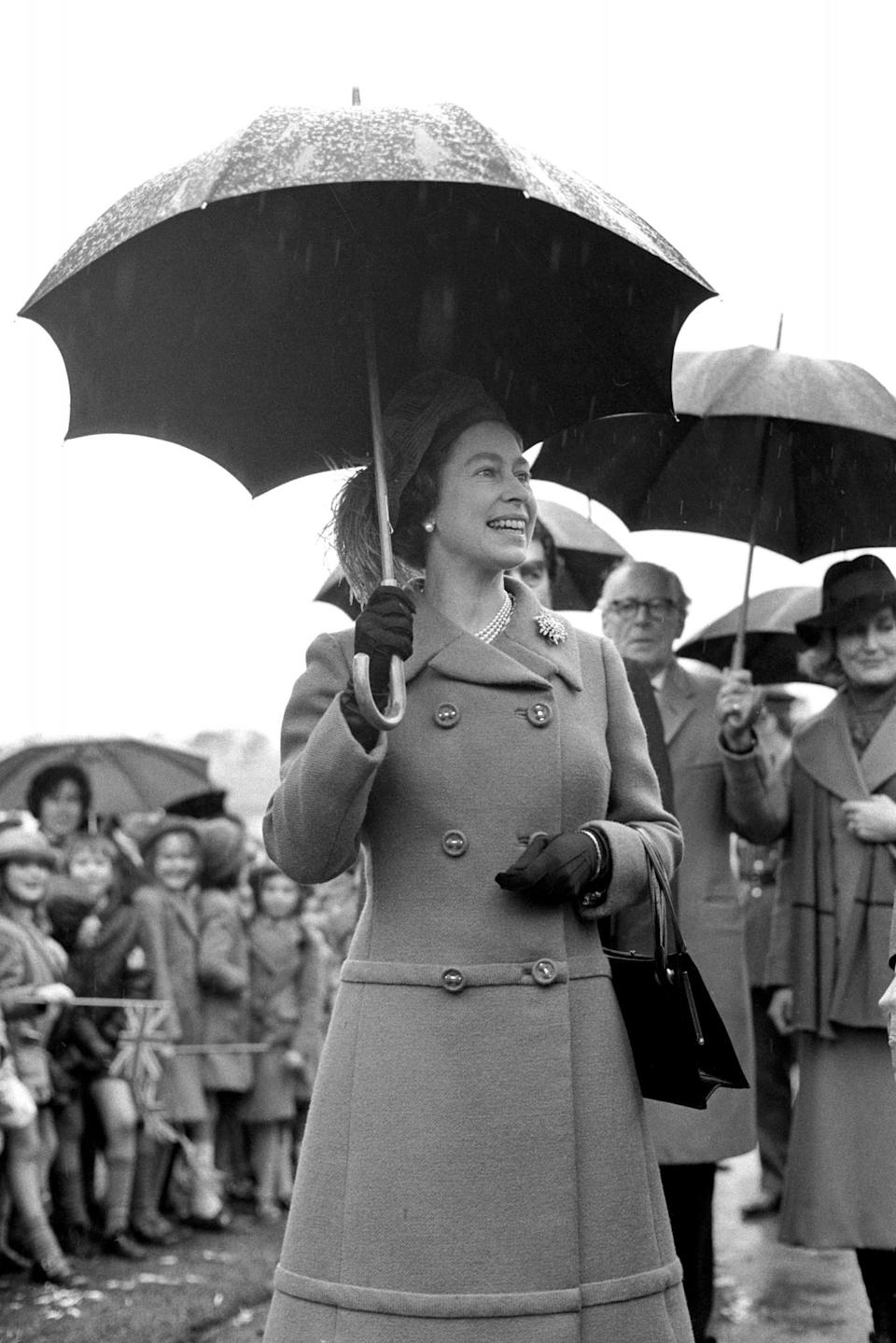 <p>On a rainy day The Queen visits the Royal Borough of Windsor and Maidenhead. (PA Archive) </p>