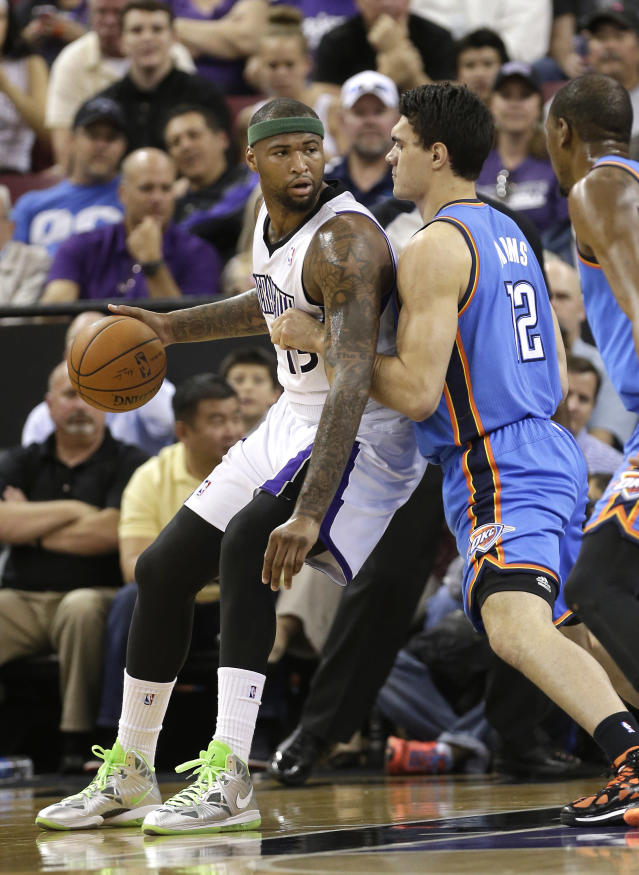 Oklahoma City Thunder center Steven Adams, right, of New Zealand, guards Sacramento Kings center DeMarcus Cousins during the first quarter of an NBA basketball game, Tuesday, April 8, 2014, in Sacramento, Calif. (AP Photo/Rich Pedroncelli)