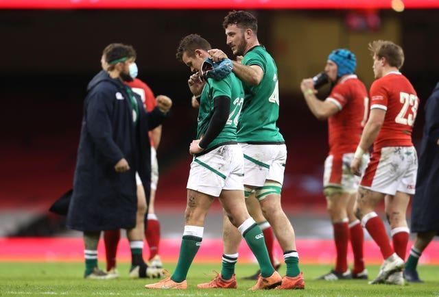 Ireland's Billy Burns was consoled by team-mates following defeat to Wales