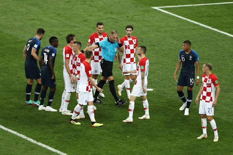 MOSCOW, RUSSIA - JULY 15: Referee Nestor Pitana holds his hand to his ear before consulting VAR and consequently awarding France a penalty during the 2018 FIFA World Cup Final between France and Croatia at Luzhniki Stadium on July 15, 2018 in Moscow, Russia. (Photo by Robert Cianflone - FIFA/FIFA via Getty Images)