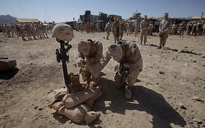 US Marine Corps soldiers pay their respects to Lance Cpl. Joshua Bernard during a memorial service in Now Zad in the Helmand Province - Julie Jacobson/AP