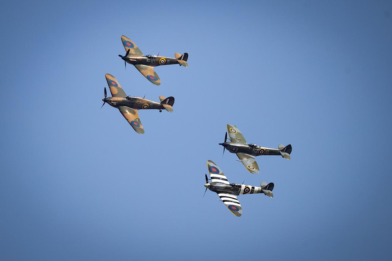 A flypast to mark the 80th anniversary of the Battle of Britain flies over Westminster Abbey, London.