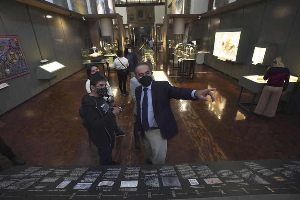 """Miguel Angel Trinidad Melendez, of the National Coordination of Museums and Exhibitions of the National Institute of Anthropology and History, takes part in the launch of """"The Greatness of Mexico"""" exhibition, displaying for the first time in the country more than 800 pieces repatriated from abroad in the last three years and others that were in safekeeping and confiscation warehouses, at the Anthropology Museum in Mexico City, Friday, Oct. 1, 2021. (AP Photo/Marco Ugarte)"""