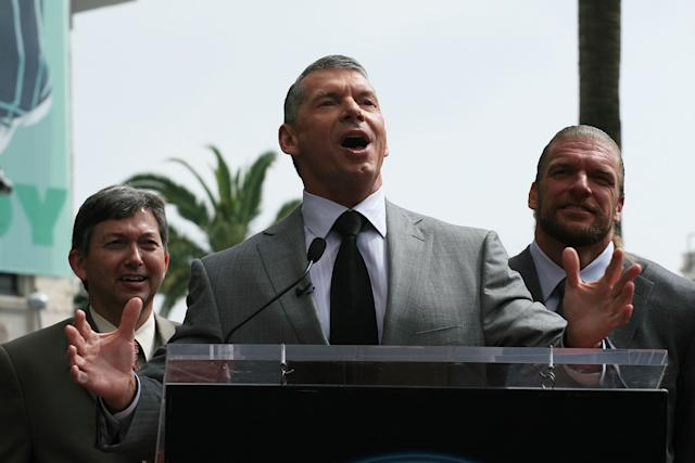HOLLYWOOD - MARCH 14: President of the Chamber of Commerce Leron Gubler (L) and WWE Superstar Triple H (R) with WWE Chairman Vince McMahon attend a ceremony honoring him with a star on the Hollywood Walk of Fame at Hollywood and Highland on March 14, 2008 in Hollywood, California (Photo by Neilson Barnard/Getty Images)