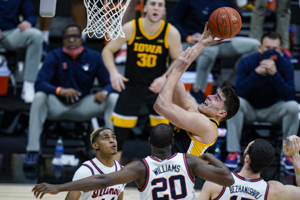 FILE - Iowa center Luka Garza shoots against Illinois in the first half of an NCAA college basketball game at the Big Ten Conference tournament in Indianapolis, in this Saturday, March 13, 2021, file photo. Garza has made The Associated Press All-America first team, announced Tuesday, March 16, 2021.(AP Photo/Michael Conroy, File)