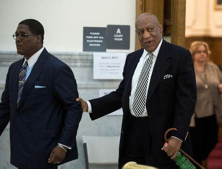 Actor Bill Cosby leaves for a lunch break during a hearing for his upcoming sexual assault trial at Montgomery County Courthouse in Norristown