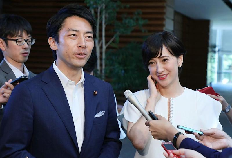 From left: Japanese environment minister Shinjirō Koizumi and Koizumi's wife, TV host Christel Takigawa, speak to the media in Tokyo. | STR/JIJI PRESS/AFP via Getty