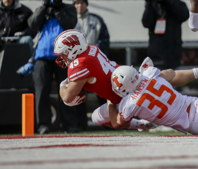 Wisconsin fullback Alec Ingold (45) scores a touchdown against Illinois linebacker Jake Hansen (35) during the second half of an NCAA college football game Saturday, Oct. 20, 2018, in Madison, Wis. Wisconsin won 49-20. (AP Photo/Andy Manis)