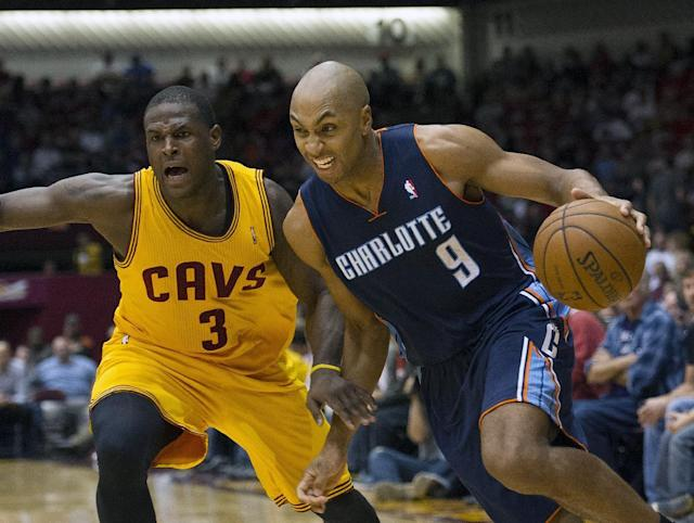 Charlotte Bobcats guard Gerald Henderson (9) drives past Cleveland Cavaliers defender Dion Waiters during the second quarter of an NBA preseason basketball game in Canton, Ohio on Tuesday, Oct. 15, 2013. (AP Photo/Phil Long)